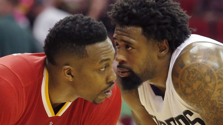 Mar 16, 2016; Houston, TX, USA; Los Angeles Clippers center DeAndre Jordan (6) talks to Houston Rockets center Dwight Howard (12) in the lane during a Clippers free throw shot in the second half at Toyota Center. The Clippers won 122-106. Mandatory Credit: Thomas B. Shea-USA TODAY Sports