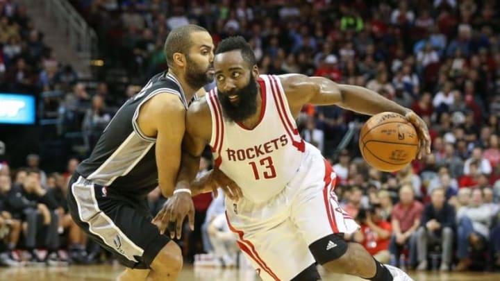Feb 27, 2016; Houston, TX, USA; Houston Rockets guard James Harden (13) dribbles past San Antonio Spurs guard Tony Parker (9) during a game at Toyota Center. Mandatory Credit: Troy Taormina-USA TODAY Sports