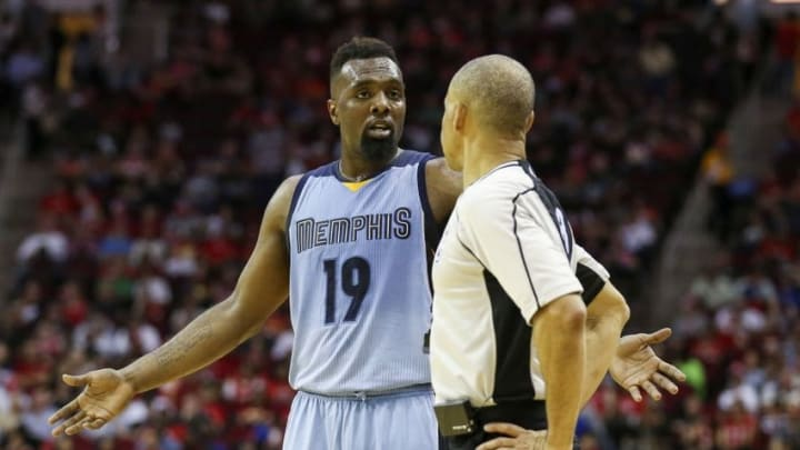 Mar 14, 2016; Houston, TX, USA; Memphis Grizzlies forward P.J. Hairston (19) talks with referee Dan Crawford (right) during the second quarter against the Houston Rockets at Toyota Center. Mandatory Credit: Troy Taormina-USA TODAY Sports