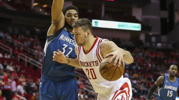 Mar 18, 2016; Houston, TX, USA; Houston Rockets forward Donatas Motiejunas (20) attempts to drive the ball around Minnesota Timberwolves center Karl-Anthony Towns (32) during the second quarter at Toyota Center. Mandatory Credit: Troy Taormina-USA TODAY Sports