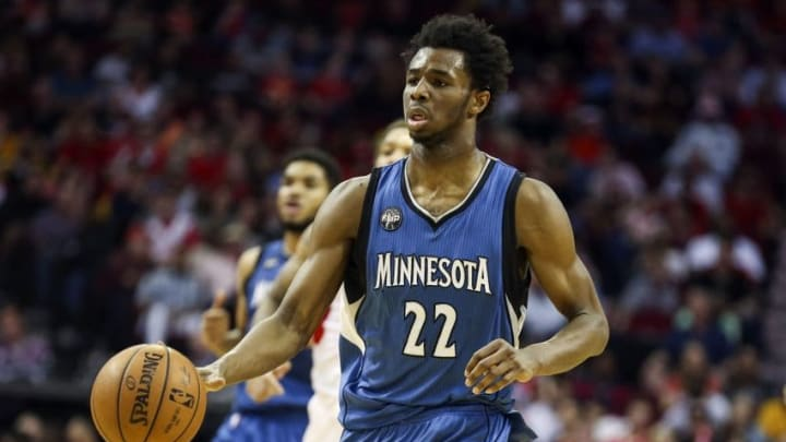 Mar 18, 2016; Houston, TX, USA; Minnesota Timberwolves guard Andrew Wiggins (22) dribbles the ball during the fourth quarter against the Houston Rockets at Toyota Center. The Rockets won 116-111. Mandatory Credit: Troy Taormina-USA TODAY Sports