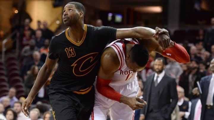 Mar 29, 2016; Cleveland, OH, USA; Cleveland Cavaliers center Tristan Thompson (13) flagrant fouls Houston Rockets center Dwight Howard (12) during the fourth quarter at Quicken Loans Arena. The Rockets won 106-100. Mandatory Credit: Ken Blaze-USA TODAY Sports