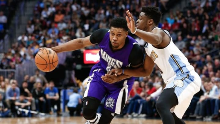 Apr 2, 2016; Denver, CO, USA; Sacramento Kings forward Rudy Gay (8) drives to the net against Denver Nuggets guard Emmanuel Mudiay (0) in the fourth quarter at the Pepsi Center. The Kings defeated the Nuggets 115-106. Mandatory Credit: Isaiah J. Downing-USA TODAY Sports