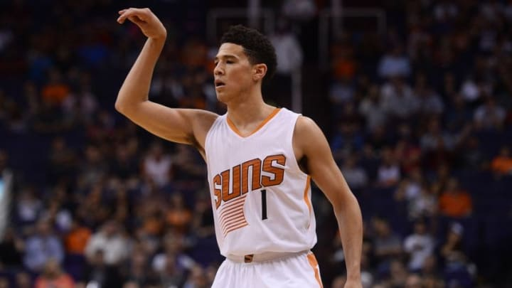 Apr 13, 2016; Phoenix, AZ, USA; Phoenix Suns guard Devin Booker (1) reacts after taking a jump shot against the Los Angeles Clippers at Talking Stick Resort Arena. The Suns won 114-105. Mandatory Credit: Joe Camporeale-USA TODAY Sports