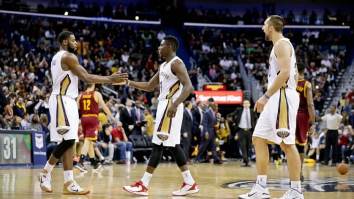 Dec 12, 2014; New Orleans, LA, USA; New Orleans Pelicans forward Tyreke Evans (1) and guard Jrue Holiday (11) celebrates after a shot against the Cleveland Cavaliers during the second half of a game at the Smoothie King Center. The Pelicans defeated the Cavaliers 119-114. Mandatory Credit: Derick E. Hingle-USA TODAY Sports