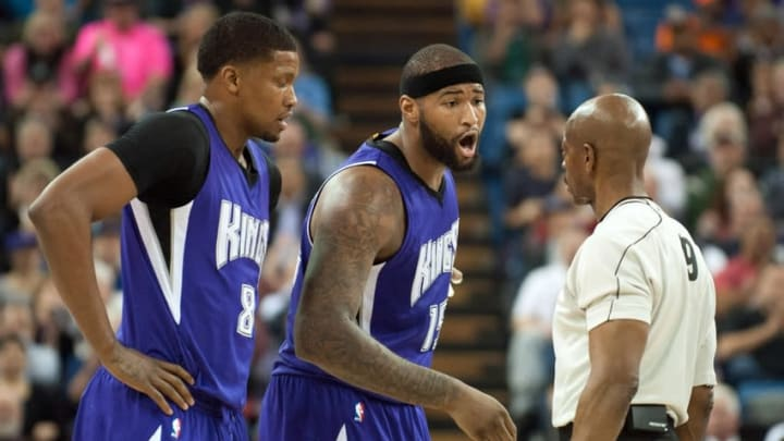 Feb 25, 2015; Sacramento, CA, USA; Sacramento Kings forward Rudy Gay (8) and center DeMarcus Cousins (15) argue a call with the referee during the second quarter of the game against the Memphis Grizzlies at Sleep Train Arena. Mandatory Credit: Ed Szczepanski-USA TODAY Sports