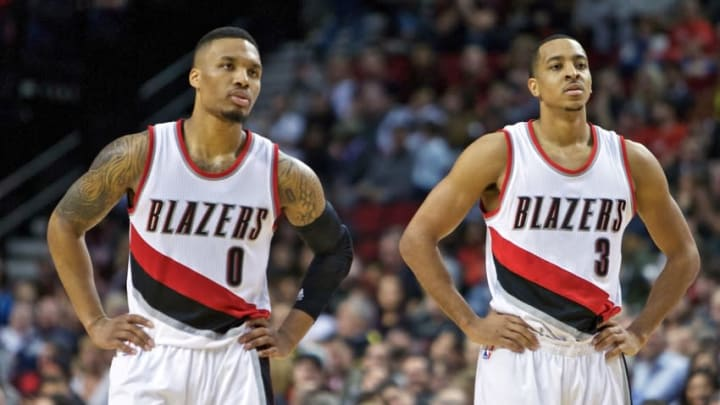Jan 29, 2016; Portland, OR, USA; Portland Trail Blazers guard Damian Lillard (0) and guard C.J. McCollum (3) look on against the Charlotte Hornets during the fourth quarter at the Moda Center. Mandatory Credit: Craig Mitchelldyer-USA TODAY Sports