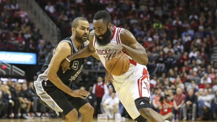 Feb 27, 2016; Houston, TX, USA; Houston Rockets guard James Harden (13) dribbles the ball as San Antonio Spurs guard Tony Parker (9) defends during the fourth quarter at Toyota Center. The Spurs defeated the Rockets 104-94. Mandatory Credit: Troy Taormina-USA TODAY Sports