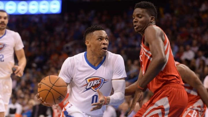 Mar 22, 2016; Oklahoma City, OK, USA; Oklahoma City Thunder guard Russell Westbrook (0) drives to the basket against Houston Rockets forward Clint Capela (15) during the fourth quarter at Chesapeake Energy Arena. Mandatory Credit: Mark D. Smith-USA TODAY Sports