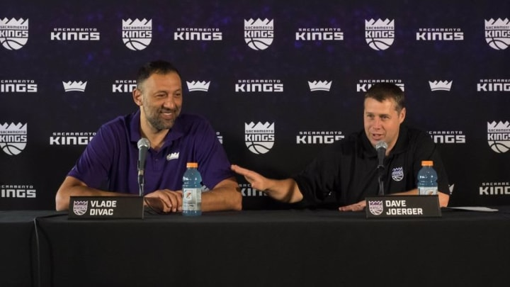 May 10, 2016; Sacramento, CA, USA; Sacramento Kings head coach Dave Joerger speaks with vice president of basketball operations and general manager Vlade Divac during a press conference at the Sacramento Kings XC (Experience Center). Mandatory Credit: Kelley L Cox-USA TODAY Sports