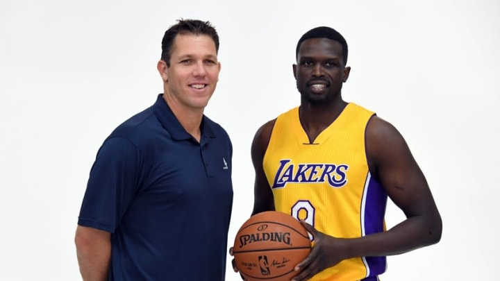 Sep 26, 2016; Los Angeles, CA, USA; Los Angeles Lakers coach Luke Walton (left) and forward Luol Deng (9) pose at media day at Toyota Sports Center.. Mandatory Credit: Kirby Lee-USA TODAY Sports