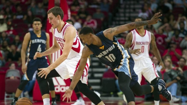 Oct 15, 2016; Houston, TX, USA; Houston Rockets forward Kyle Wiltjer (30) and Memphis Grizzlies forward Troy Williams (10) fight for the loose ball during the second half at the Toyota Center. The Grizzlies defeat the Rockets 134-125. Mandatory Credit: Jerome Miron-USA TODAY Sports