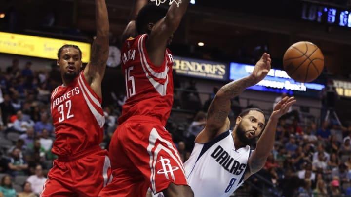 Oct 19, 2016; Dallas, TX, USA; Dallas Mavericks guard Deron Williams (8) passes around Houston Rockets center Clint Capela (15) and guard K.J. McDaniels (32) during the second quarter at American Airlines Center. Mandatory Credit: Kevin Jairaj-USA TODAY Sports