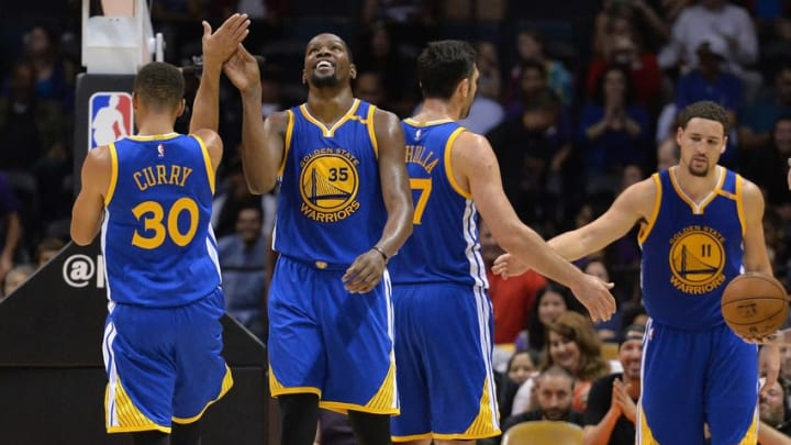 Oct 19, 2016; San Diego, CA, USA; Golden State Warriors forward Kevin Durant (35) is congratulated by guard Stephen Curry (30) during the fourth quarter against the Los Angeles Lakers at Valley View Casino Center. Mandatory Credit: Jake Roth-USA TODAY Sports