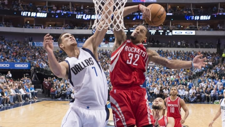 Oct 28, 2016; Dallas, TX, USA; Dallas Mavericks forward Dwight Powell (7) and Houston Rockets guard K.J. McDaniels (32) fight for the rebound during the game at the American Airlines Center. The Rockets defeat the Mavericks 106-98. Mandatory Credit: Jerome Miron-USA TODAY Sports