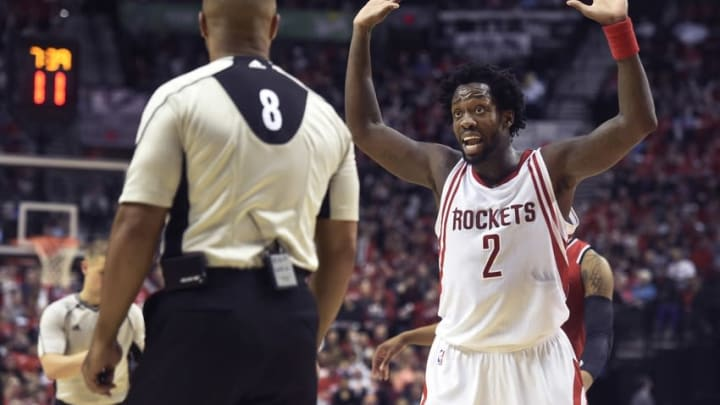 Feb 25, 2016; Portland, OR, USA; Houston Rockets guard Patrick Beverley (2) reacts to a call by referee Marc Davis (8) during the third quarter of the game against the Portland Trail Blazers at the Moda Center at the Rose Quarter. The Rockets won the game 119-105. Mandatory Credit: Steve Dykes-USA TODAY Sports