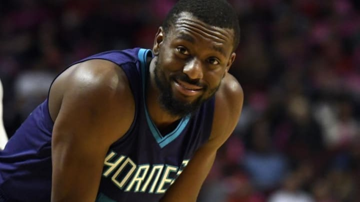 Oct 17, 2016; Chicago, IL, USA; Charlotte Hornets guard Kemba Walker (15) smiles during the second half of a game against the Chicago Bulls at the United Center. The Hornets won 108-104 in overtime. Mandatory Credit: David Banks-USA TODAY Sports