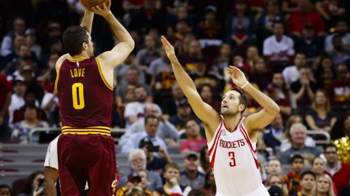 Nov 1, 2016; Cleveland, OH, USA; Cleveland Cavaliers forward Kevin Love (0) shoots over Houston Rockets forward Ryan Anderson (3) in the first half at Quicken Loans Arena. Mandatory Credit: Rick Osentoski-USA TODAY Sports