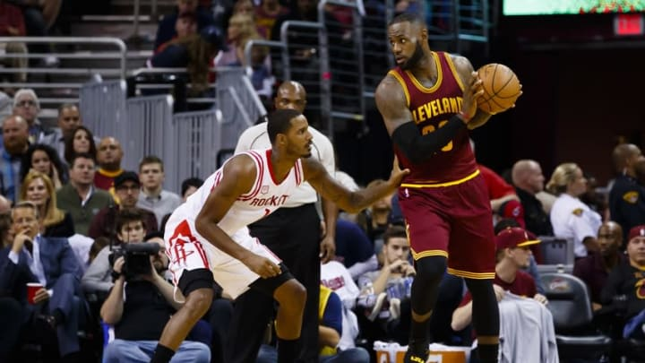 Nov 1, 2016; Cleveland, OH, USA; Cleveland Cavaliers forward LeBron James (23) is defended by Houston Rockets forward Trevor Ariza (1) in the first half at Quicken Loans Arena. Mandatory Credit: Rick Osentoski-USA TODAY Sports