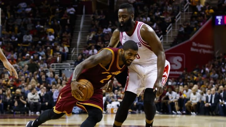 Nov 1, 2016; Cleveland, OH, USA; Cleveland Cavaliers guard Kyrie Irving (2) controls the ball defended by Houston Rockets guard James Harden (13) in the second half at Quicken Loans Arena. Cleveland won 128-120. Mandatory Credit: Rick Osentoski-USA TODAY Sports