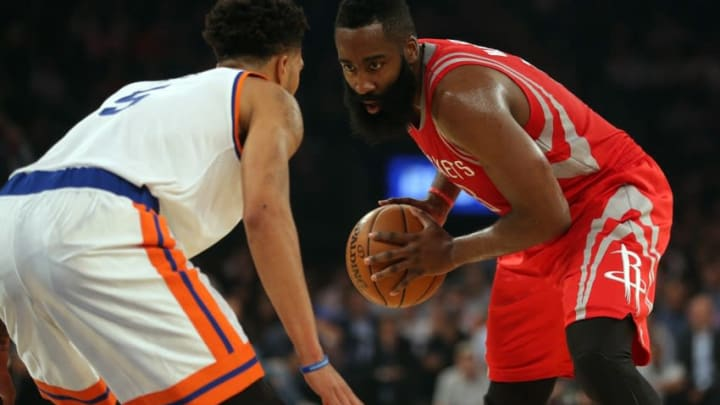Nov 2, 2016; New York, NY, USA; Houston Rockets shooting guard James Harden (13) controls the ball against New York Knicks shooting guard Courtney Lee (5) during the first quarter at Madison Square Garden. Mandatory Credit: Brad Penner-USA TODAY Sports