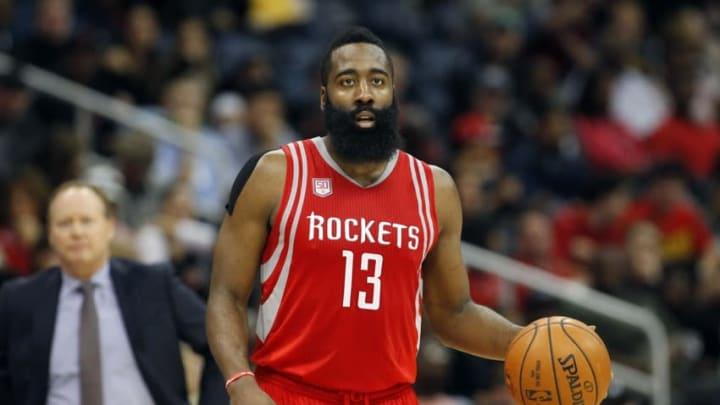 Nov 5, 2016; Atlanta, GA, USA; Houston Rockets guard James Harden (13) dribbles against the Atlanta Hawks in the first quarter at Philips Arena. Mandatory Credit: Brett Davis-USA TODAY Sports
