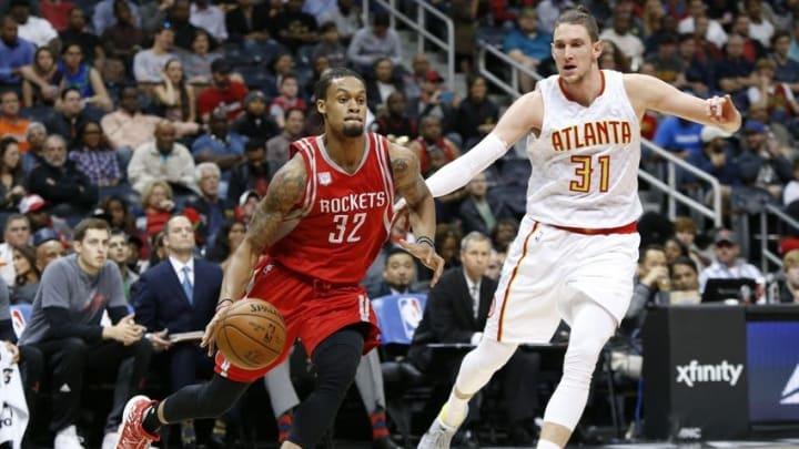 Nov 5, 2016; Atlanta, GA, USA; Houston Rockets guard K.J. McDaniels (32) drives past Atlanta Hawks forward Mike Muscala (31) in the first quarter at Philips Arena. Mandatory Credit: Brett Davis-USA TODAY Sports