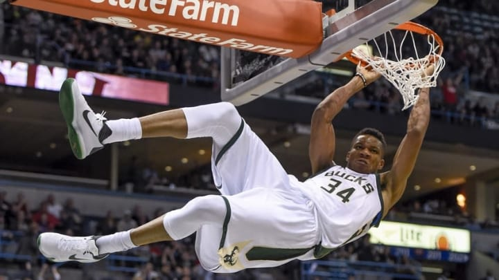 Nov 5, 2016; Milwaukee, WI, USA; Milwaukee Bucks forward Giannis Antetokounmpo (34) hangs onto the rim after dunking for a basket in the third quarter during the game against the Sacramento Kings at BMO Harris Bradley Center. The Bucks beat the Kings 117-91. Mandatory Credit: Benny Sieu-USA TODAY Sports