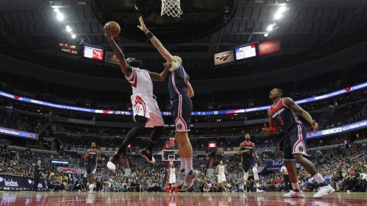 Nov 7, 2016; Washington, DC, USA; Houston Rockets guard James Harden (13) shoots the ball as Washington Wizards center Marcin Gortat (13) defends in the fourth quarter at Verizon Center. The Rockets won 114-106. Mandatory Credit: Geoff Burke-USA TODAY Sports