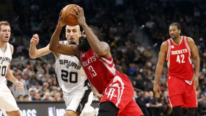 Nov 9, 2016; San Antonio, TX, USA; Houston Rockets shooting guard James Harden (13) drives to the basket while guarded by San Antonio Spurs shooting guard Manu Ginobili (20) during the second half at AT&T Center. Mandatory Credit: Soobum Im-USA TODAY Sports