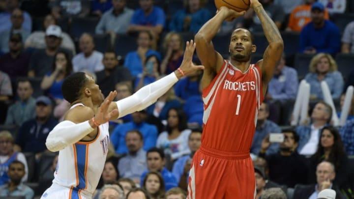 Nov 16, 2016; Oklahoma City, OK, USA; Houston Rockets forward Trevor Ariza (1) shoots the ball over Oklahoma City Thunder guard Russell Westbrook (0) during the first quarter at Chesapeake Energy Arena. Mandatory Credit: Mark D. Smith-USA TODAY Sports
