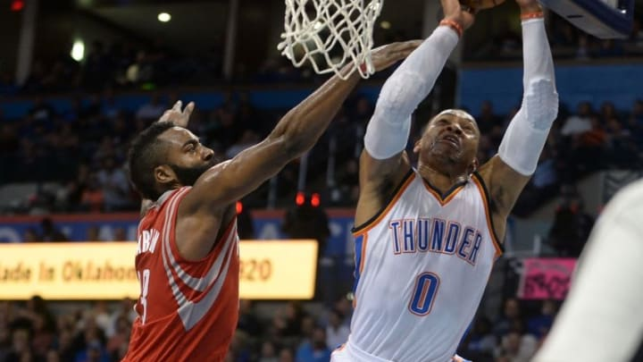 Nov 16, 2016; Oklahoma City, OK, USA; Oklahoma City Thunder guard Russell Westbrook (0) drives to the basket in front of Houston Rockets guard James Harden (13) during the fourth quarter at Chesapeake Energy Arena. Mandatory Credit: Mark D. Smith-USA TODAY Sports
