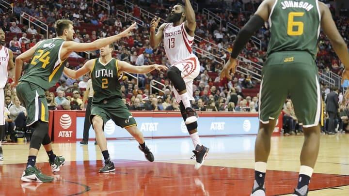 Nov 19, 2016; Houston, TX, USA; Houston Rockets guard James Harden (13) drives to the basket against Utah Jazz center Jeff Withey (24) and forward Joe Ingles (2) in the second half at Toyota Center. Rockets won 111-102. Mandatory Credit: Thomas B. Shea-USA TODAY Sports