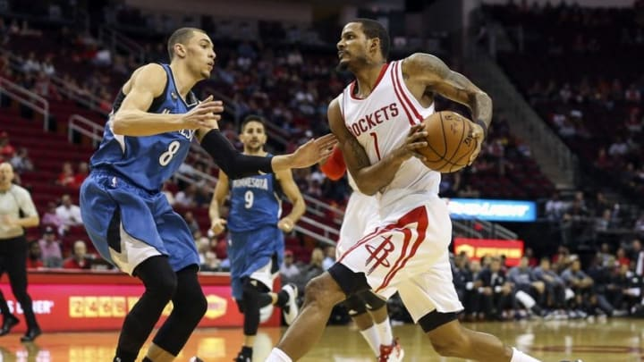 Mar 18, 2016; Houston, TX, USA; Houston Rockets forward Trevor Ariza (1) drives to the basket with the ball as Minnesota Timberwolves guard Zach LaVine (8) defends during the first quarter at Toyota Center. Mandatory Credit: Troy Taormina-USA TODAY Sports