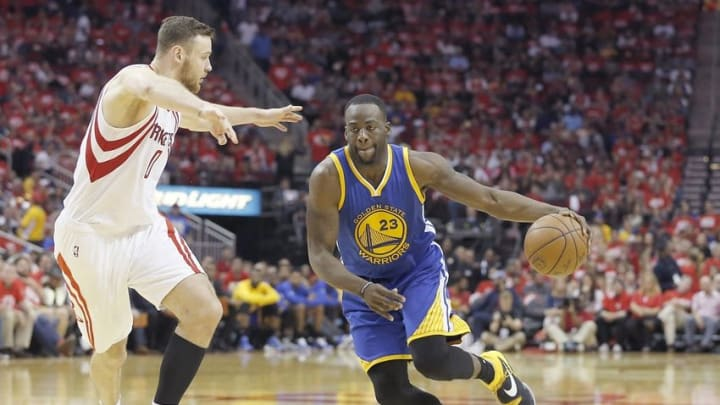 Apr 24, 2016; Houston, TX, USA; Golden State Warriors forward Draymond Green (23) drives against Houston Rockets forward Donatas Motiejunas (20) in the second half in game four of the first round of the NBA Playoffs at Toyota Center. Golden State Warriors won 121 to 94. Mandatory Credit: Thomas B. Shea-USA TODAY Sports