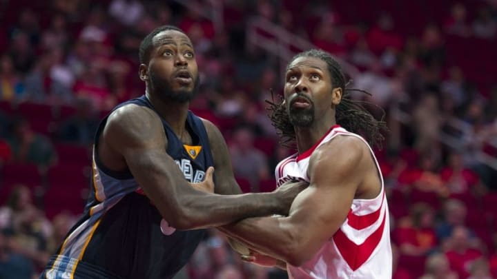 Oct 15, 2016; Houston, TX, USA; Memphis Grizzlies forward JaMychal Green (0) and Houston Rockets center Nene Hilario (42) fight for position during the second quarter at the Toyota Center. Mandatory Credit: Jerome Miron-USA TODAY Sports