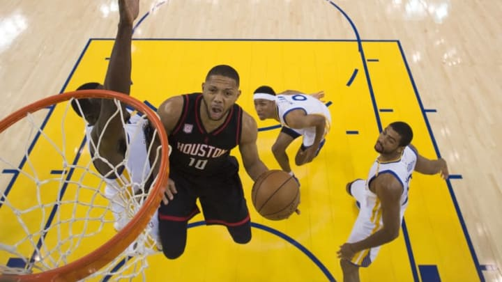 December 1, 2016; Oakland, CA, USA; Houston Rockets guard Eric Gordon (10) shoots the basketball against Golden State Warriors forward Draymond Green (23), guard Patrick McCaw (0), and forward James Michael McAdoo (20) during the game at Oracle Arena. The Rockets defeated the Warriors 132-127 in double overtime. Mandatory Credit: Kyle Terada-USA TODAY Sports