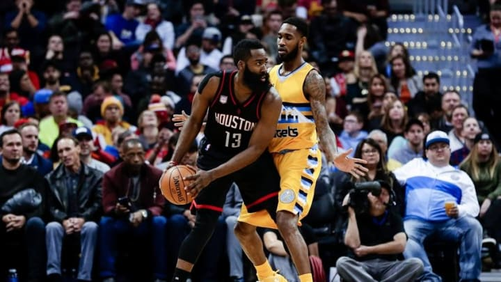 Dec 2, 2016; Denver, CO, USA; Denver Nuggets guard Will Barton (5) guards Houston Rockets guard James Harden (13) in the second quarter at the Pepsi Center. Mandatory Credit: Isaiah J. Downing-USA TODAY Sports