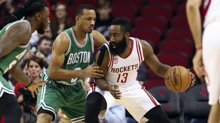 Dec 5, 2016; Houston, TX, USA; Houston Rockets guard James Harden (13) controls the ball as Boston Celtics guard Avery Bradley (0) defends during the first quarter at Toyota Center. Mandatory Credit: Troy Taormina-USA TODAY Sports