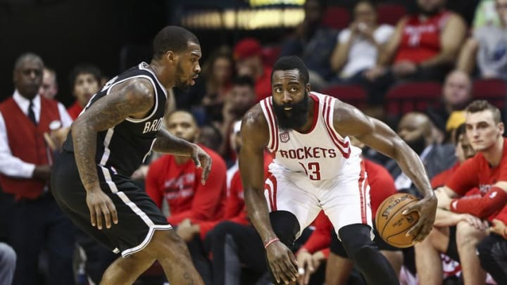 Dec 12, 2016; Houston, TX, USA; Houston Rockets guard James Harden (13) dribbles the ball as Brooklyn Nets guard Sean Kilpatrick (6) defends during the third quarter at Toyota Center. Mandatory Credit: Troy Taormina-USA TODAY Sports