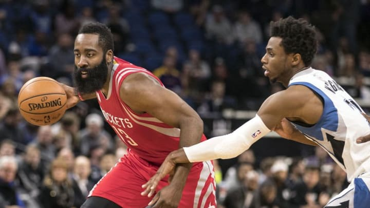 Dec 17, 2016; Minneapolis, MN, USA; Houston Rockets guard James Harden (13) drives to the basket past Minnesota Timberwolves forward Andrew Wiggins (22) in the first half at Target Center. Mandatory Credit: Jesse Johnson-USA TODAY Sports