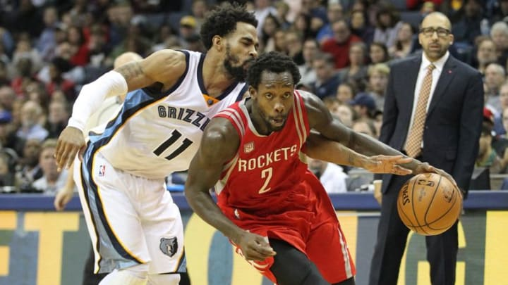 Dec 23, 2016; Memphis, TN, USA; Houston Rockets guard Patrick Beverley (2) drives as Memphis Grizzlies Mike Conley (11) attempts a steal the ball in the second half at FedExForum. Memphis defeated Houston 115-109. Mandatory Credit: Nelson Chenault-USA TODAY Sports