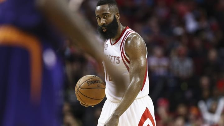 Dec 26, 2016; Houston, TX, USA; Houston Rockets guard James Harden (13) brings the ball up the court during the third quarter against the Phoenix Suns at Toyota Center. Mandatory Credit: Troy Taormina-USA TODAY Sports