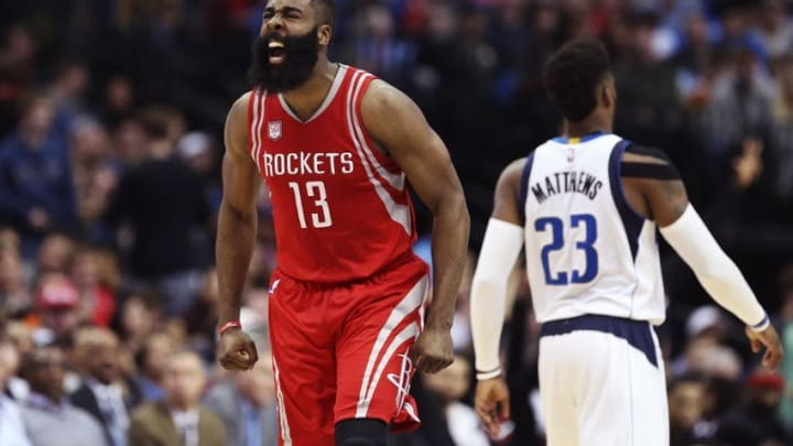 Dec 27, 2016; Dallas, TX, USA; Houston Rockets guard James Harden (13) reacts in front of Dallas Mavericks guard Wesley Matthews (23) after scoring during the first half at American Airlines Center. Mandatory Credit: Kevin Jairaj-USA TODAY Sports