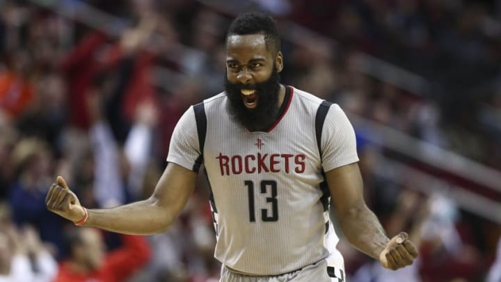 Dec 30, 2016; Houston, TX, USA; Houston Rockets guard James Harden (13) celebrates after getting an assist to give Harden a triple-double during the fourth quarter against the Los Angeles Clippers at Toyota Center. Mandatory Credit: Troy Taormina-USA TODAY Sports