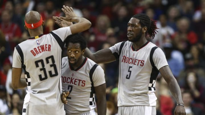 Dec 30, 2016; Houston, TX, USA; Houston Rockets forward Montrezl Harrell (5) celebrates with forward Corey Brewer (33) and guard Patrick Beverley (2) after a play during the fourth quarter against the Los Angeles Clippers at Toyota Center. Mandatory Credit: Troy Taormina-USA TODAY Sports