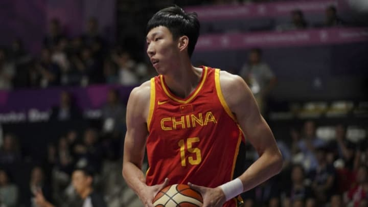 JAKARTA, INDONESIA - AUGUST 21: Zhou Qi #15 of China in action during Basketball Men's Preliminary Round Group D match between Philippines and China on day three of the Asian Games on August 21, 2018 in Jakarta, Indonesia. (Photo by Fred Lee/Getty Images)