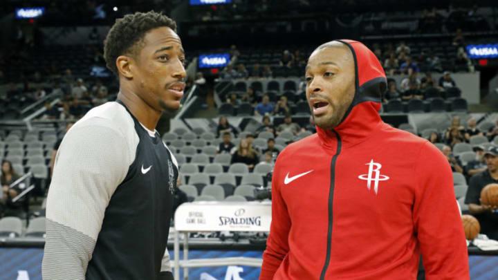 DeMar DeRozan #10 of the San Antonio Spurs talks with PJ Tucker #17 of the Houston Rockets (Photo by Edward A. Ornelas/Getty Images)