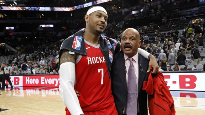 Carmelo Anthony #7 of the Houston Rockets walks off the court with assistant coach John Lucas (Photo by Edward A. Ornelas/Getty Images)