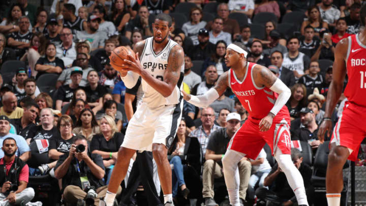 SAN ANTONIO, TX - OCTOBER 7: LaMarcus Aldridge #12 of the San Antonio Spurs handles the ball against the Houston Rockets on October 7, 2018 at AT&T Center, in San Antonio, Texas. NOTE TO USER: User expressly acknowledges and agrees that, by downloading and/or using this Photograph, user is consenting to the terms and conditions of the Getty Images License Agreement. Mandatory Copyright Notice: Copyright 2018 NBAE (Photo by Nathaniel S. Butler/NBAE via Getty Images)